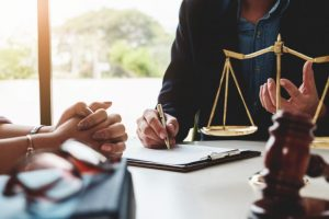 A two person at table and law aid on table