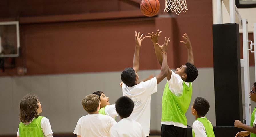A group of kids playing basketball