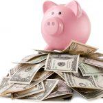 A pig bank on a money