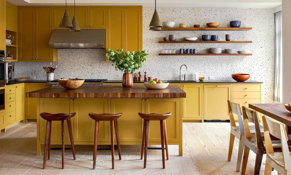 A kitchen room filled with furniture